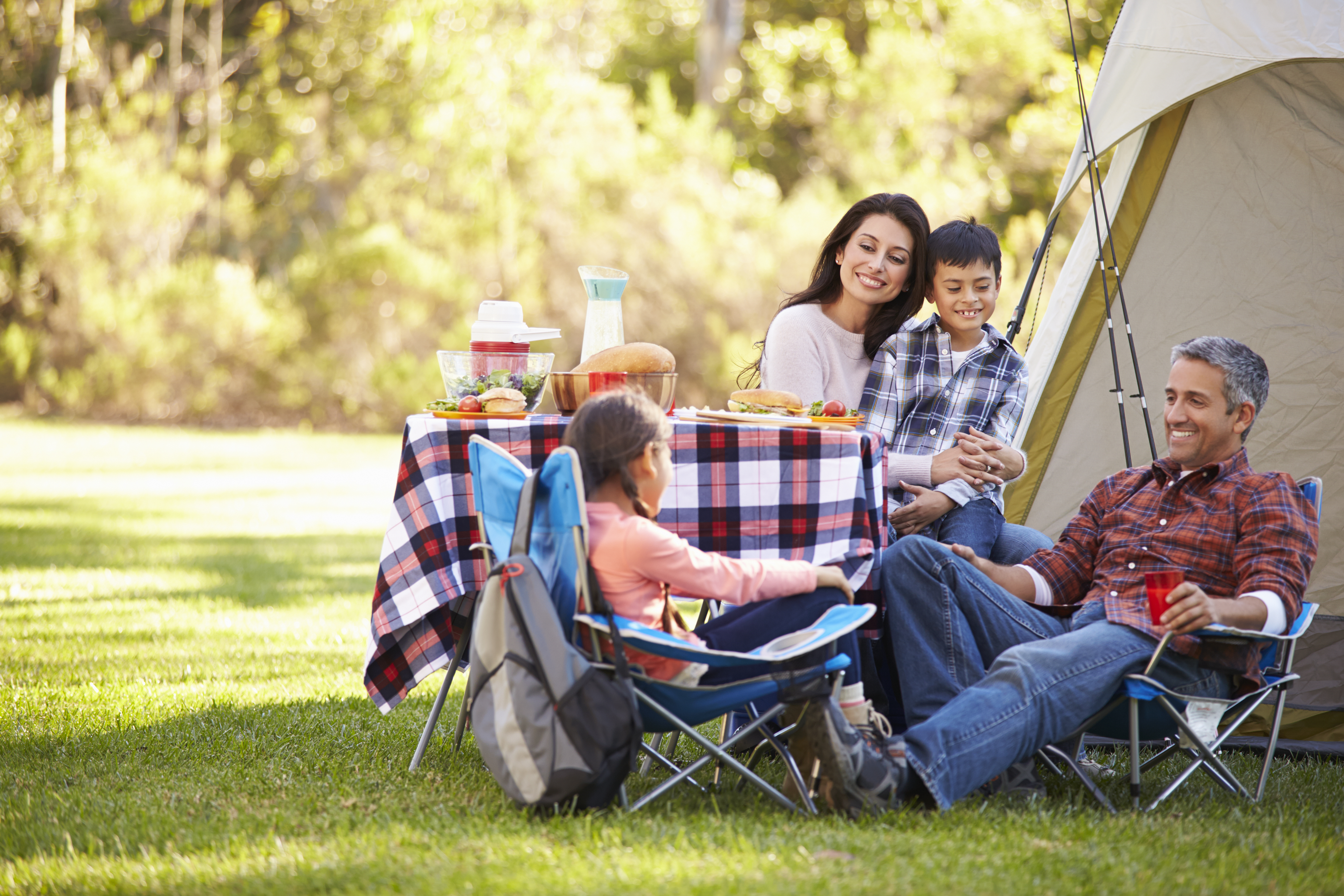 priority health personal wellness camping in michigan family outside tent