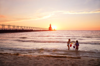priority health personal wellness water safety kids play at lake mi beach