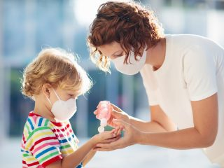 ThinkHealth healthcare 101 mother and son wearing masks using hand sanitizer