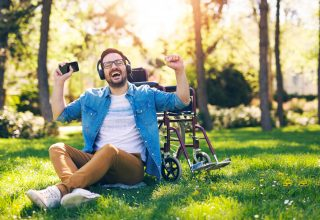 ThinkHealth personal wellness music in every day life man listening to music
