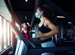 ThinkHealth personal wellness gym safety during covid woman running in mask